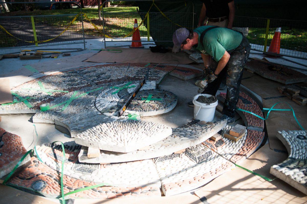 People assemble mosaic
