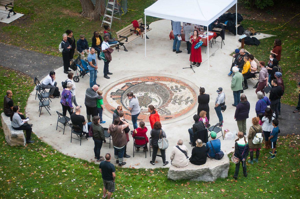 Community gathers around mosaic
