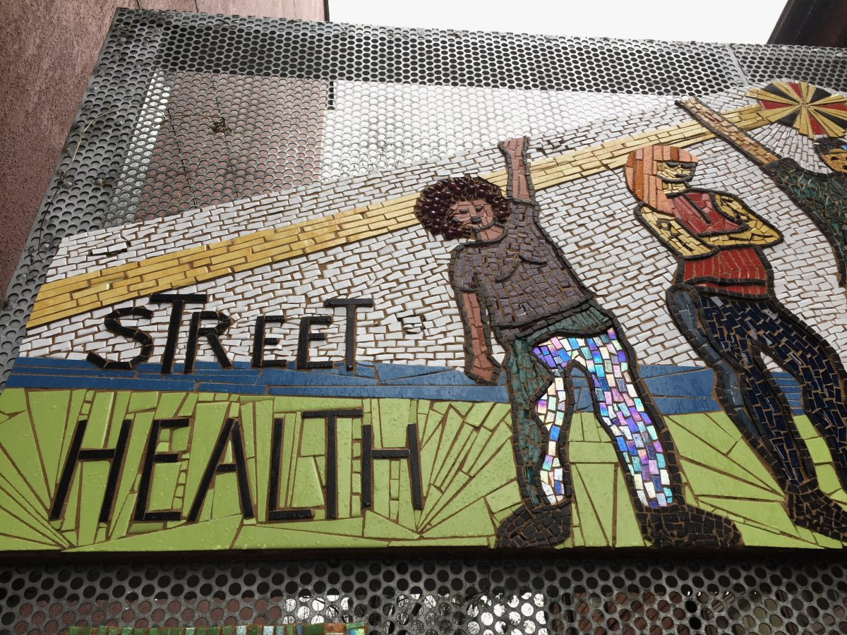 Detail from mosaic on gate of Street Health