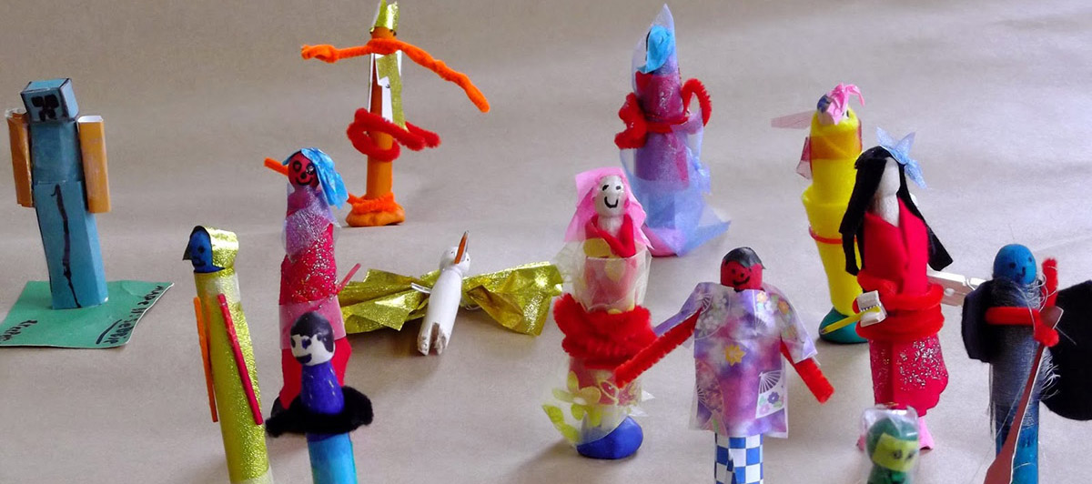 Handmade stick dolls made out of colourful paper and fabric