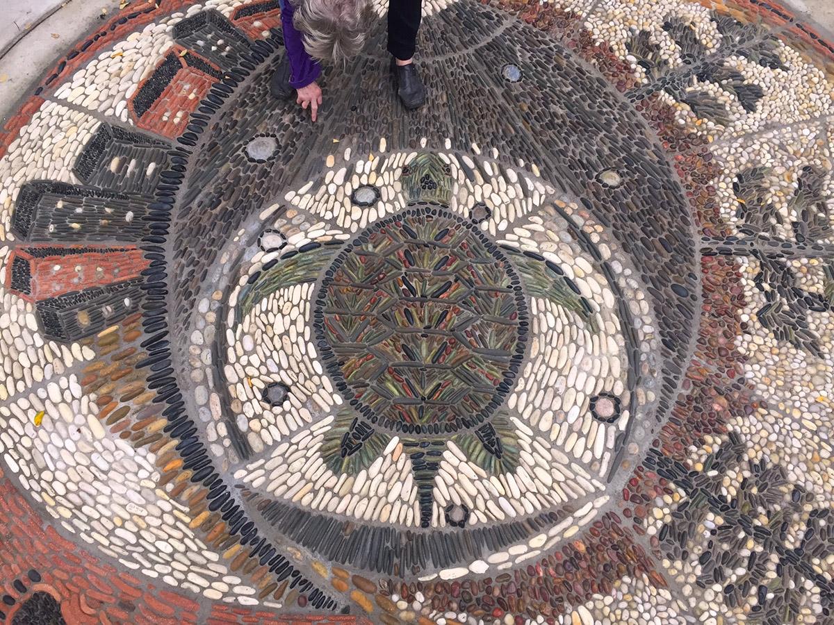 Milestone pebble mosaic