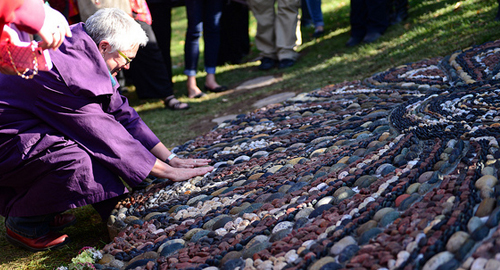 Woman touches mosaic in Centennial Park