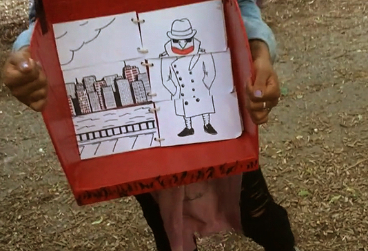 Child holds illustration of Rock Robin