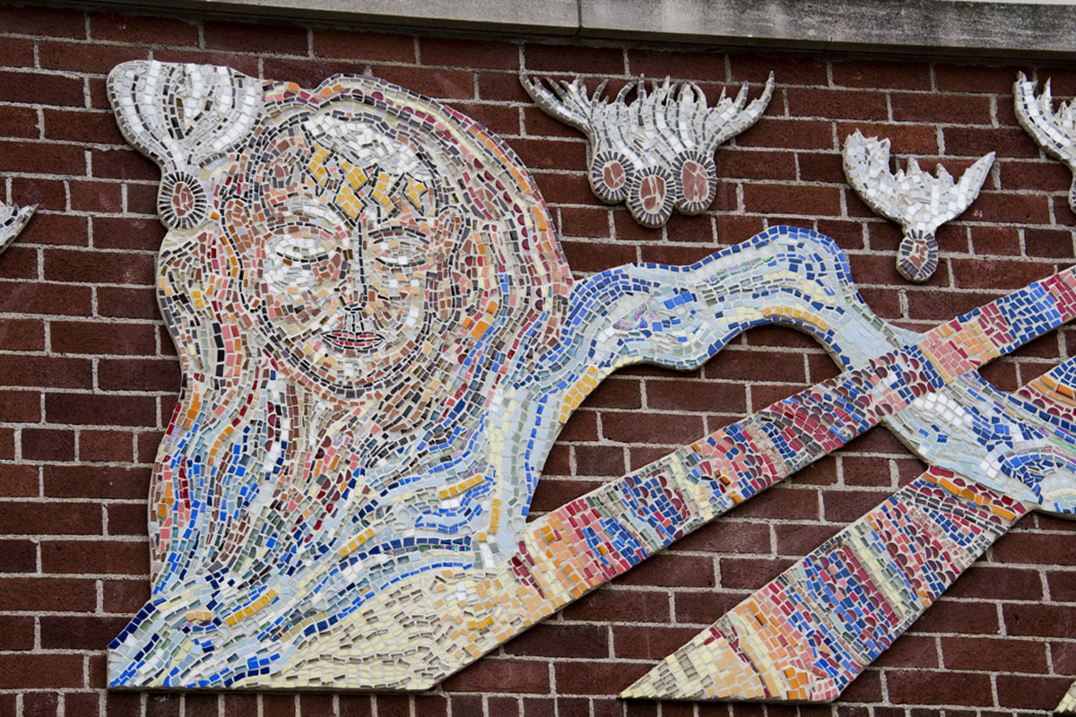 Pembroke Youth Mural Project mosaic - right half featuring artwork of a face, river, sun rays, and floating seed pods. Photo by Doug De La Matter